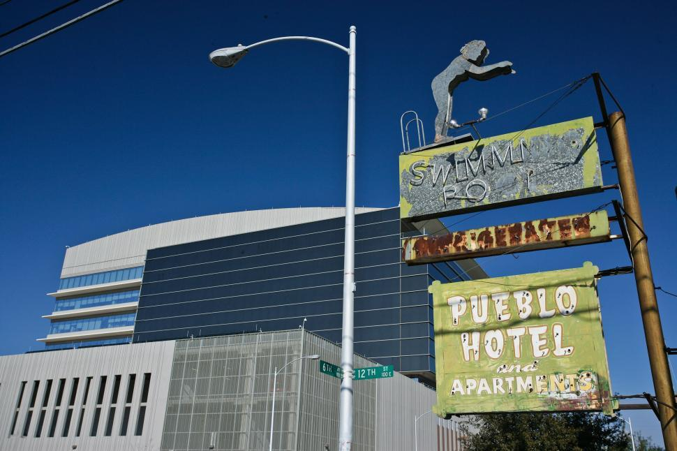Download Free Stock HD Photo of Old Pueblo Hotel Sign Online