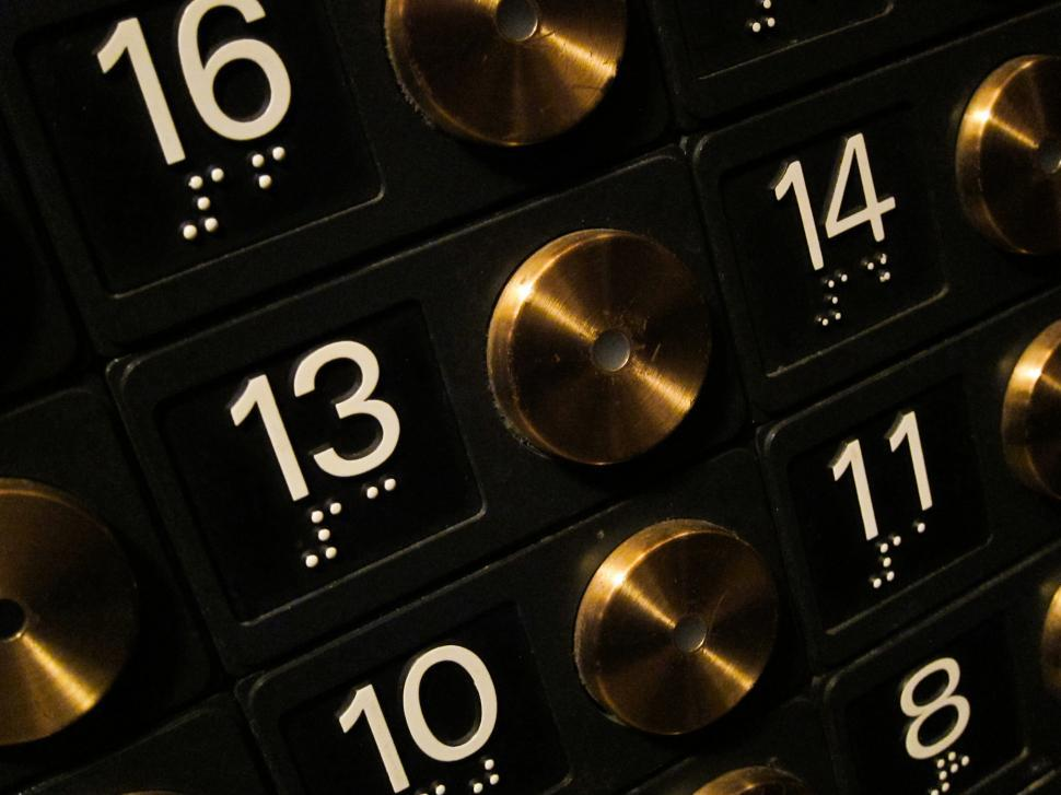 Download Free Stock HD Photo of Elevator buttons, focus on 13 Online