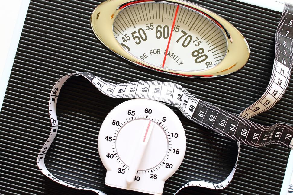 Download Free Stock HD Photo of Racing against the clock to lose weight Online