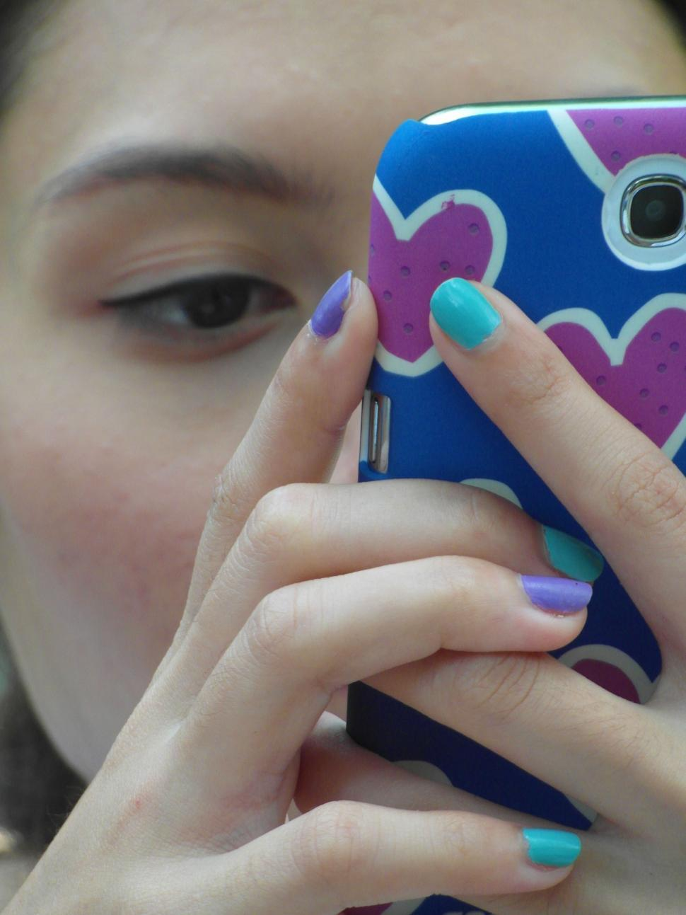 Download Free Stock HD Photo of Girl Using Touch Screen Phone Online