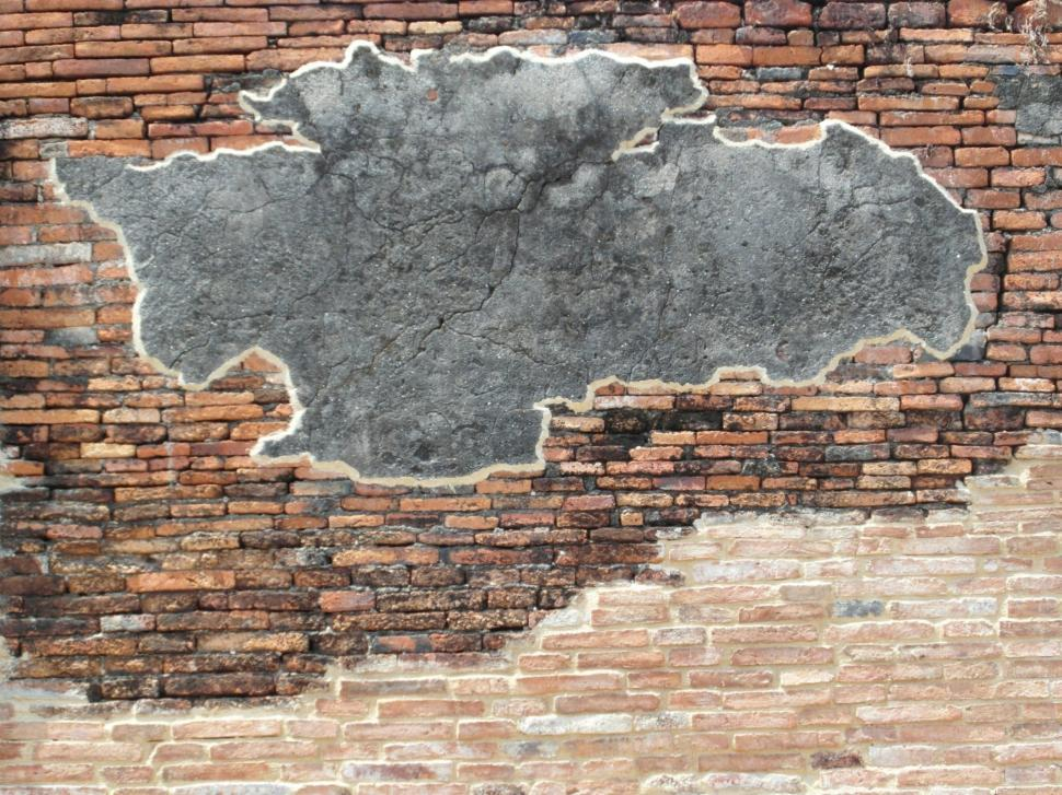 Download Free Stock Photo of Brick Wall with Blank Concrete Patch