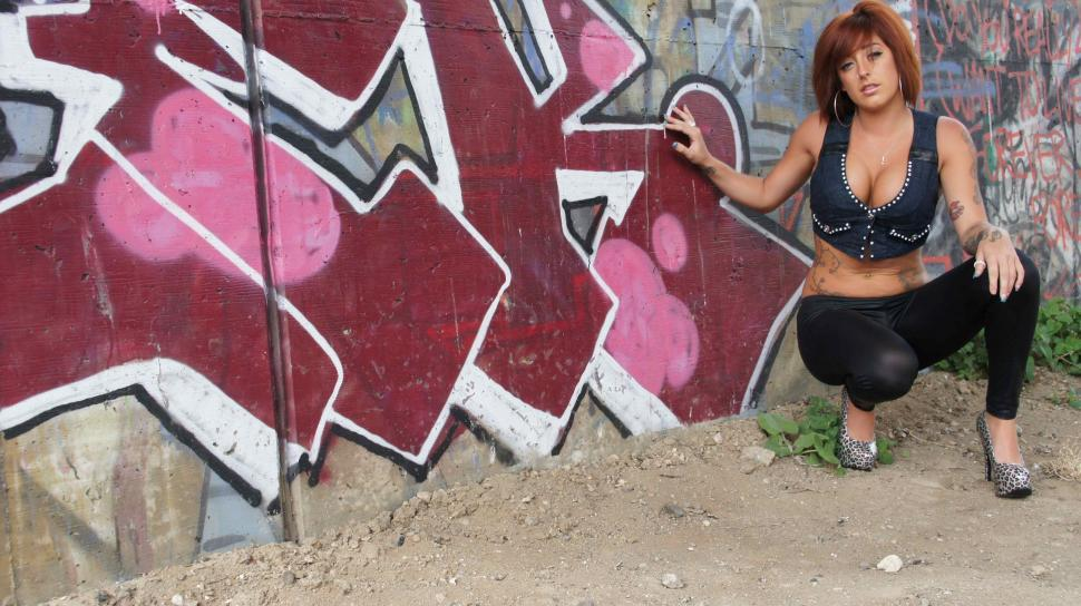 Download Free Stock Photo of Model Showing off Graffiti
