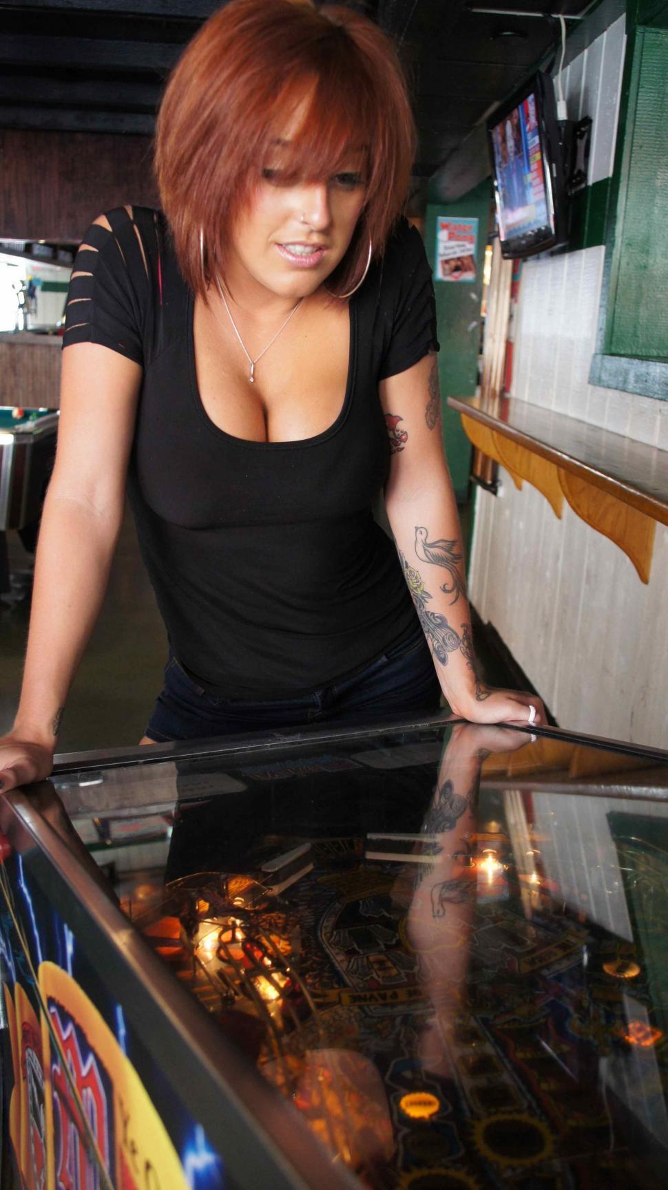Download Free Stock Photo of Woman Playing Pinball
