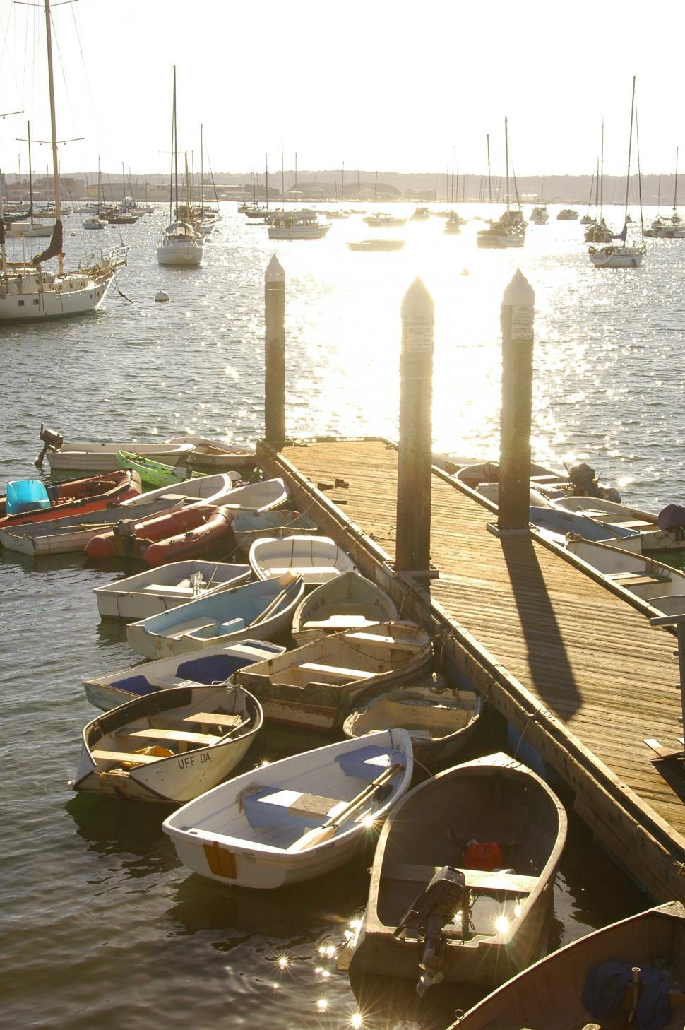 Download Free Stock HD Photo of Row Boats and Sailboats in the Marina Online