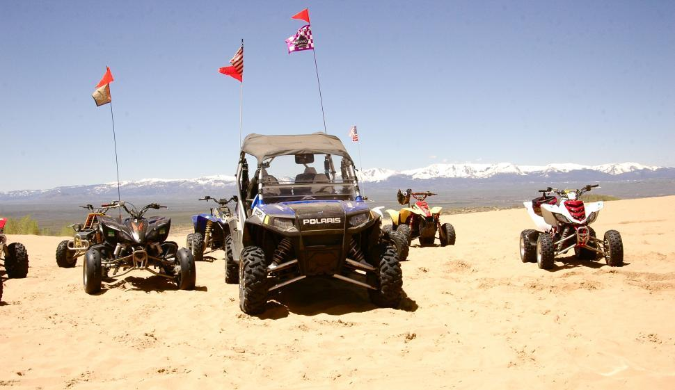 Download Free Stock Photo of ATVs await Fun at the Sand Dunes
