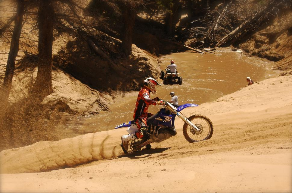 Download Free Stock Photo of Motorcycle Hill Climbs the Sand Dunes