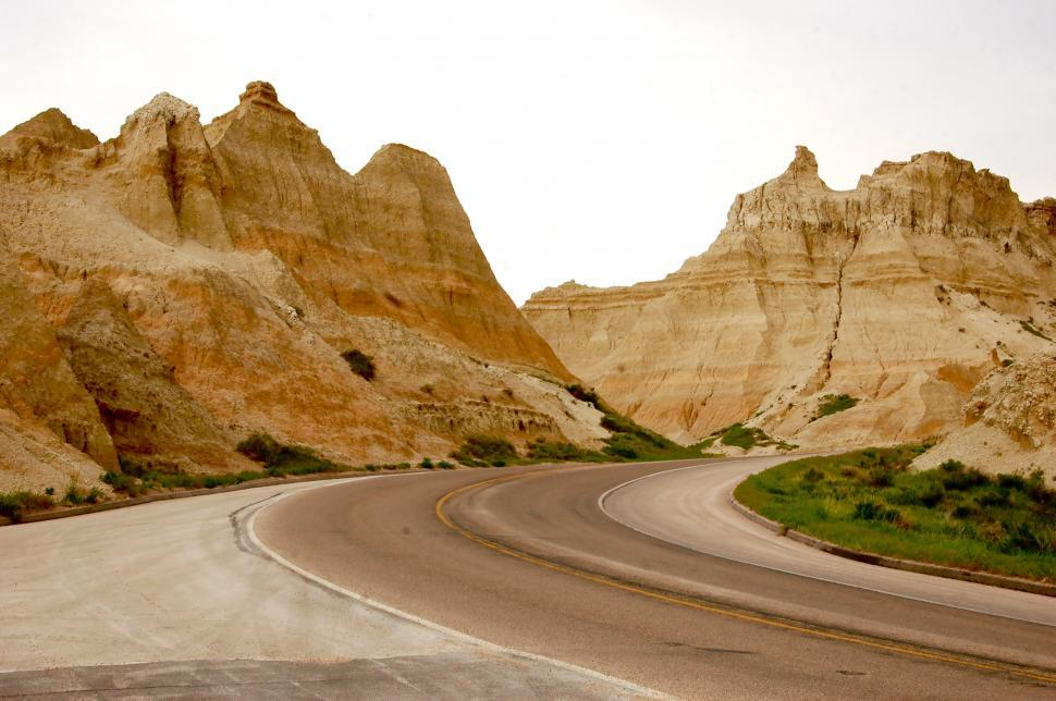 Download Free Stock Photo of Winding Desert Road through Badlands