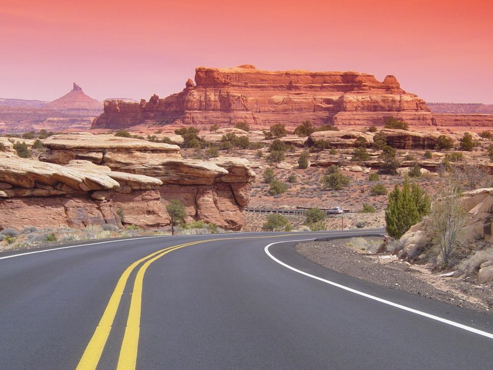 Download Free Stock HD Photo of Desert Highway into Red Rock Arid Canyonlands Online