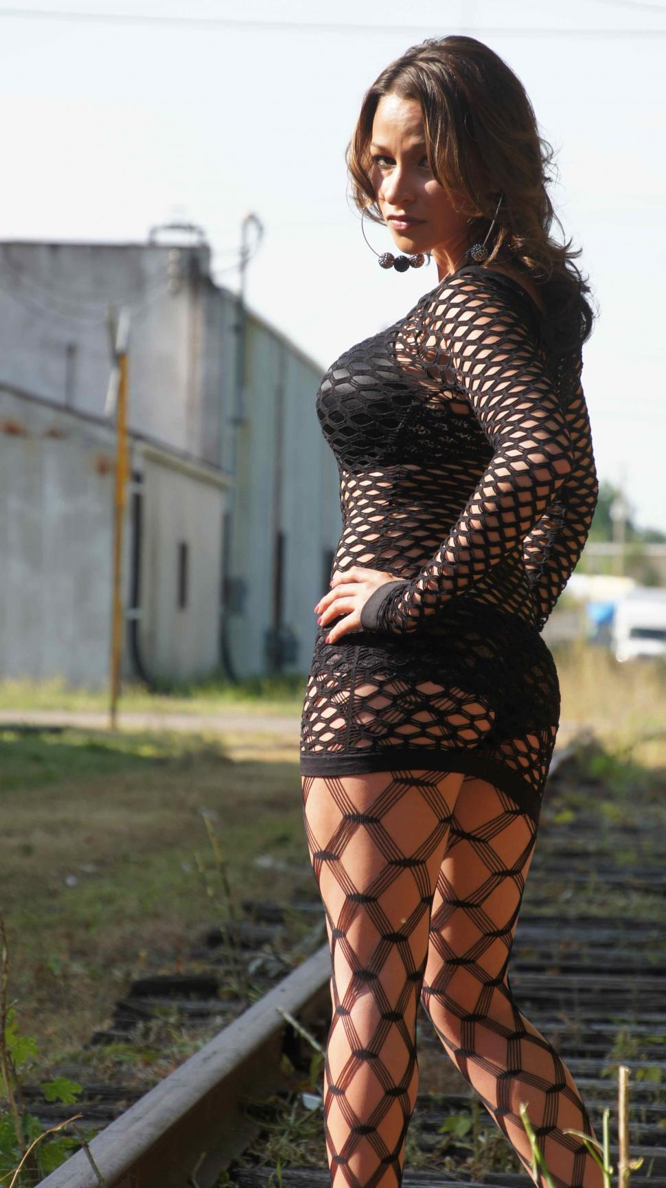 Download Free Stock Photo of Woman in Fishnets Stands on Train Track