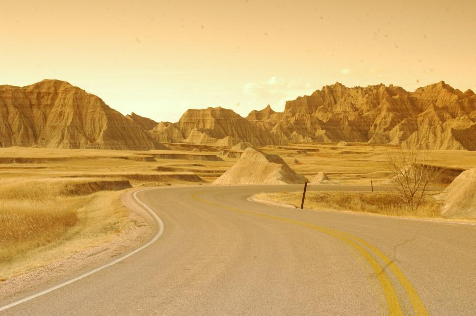 Download Free Stock Photo of Lonely Desert Road through the Badlands