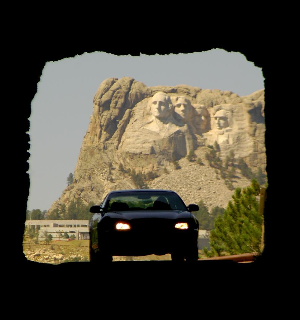 Download Free Stock HD Photo of Car drives tunnel with Mount Rushmore Online