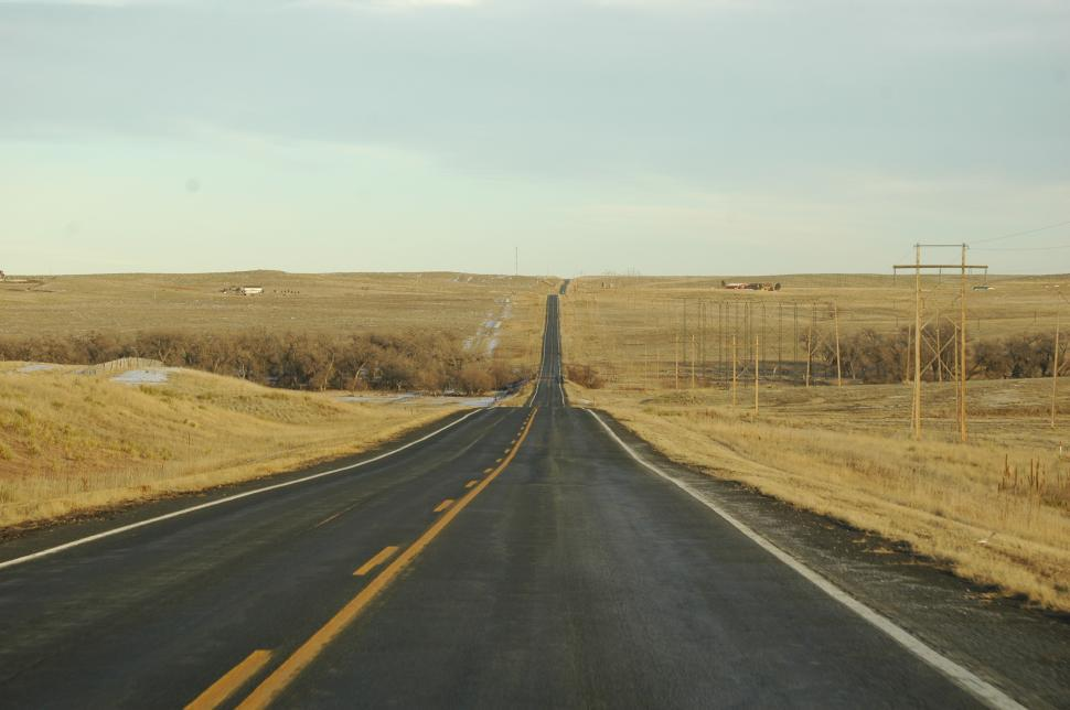 Download Free Stock Photo of Lonely Highway down a Country Landscape