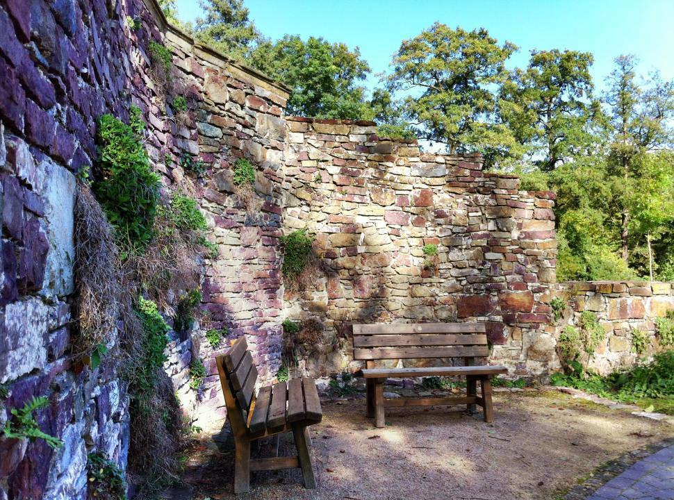 Download Free Stock Photo of Two park benches before a historical wall ruin