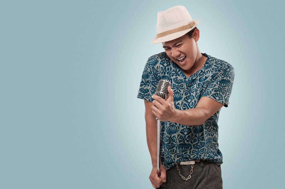 Download Free Stock HD Photo of Man singing in to microphone Online