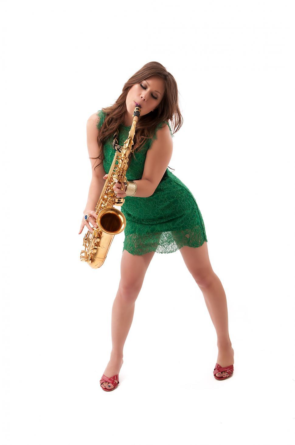Download Free Stock Photo of Young performer playing the saxophone