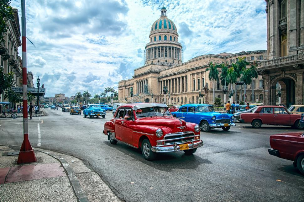 Download Free Stock Photo of El Capitolio and a red car