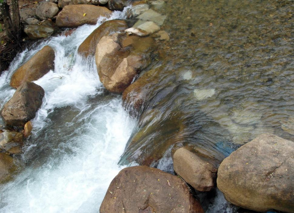 Download Free Stock Photo of Small Waterfall Over Boulders
