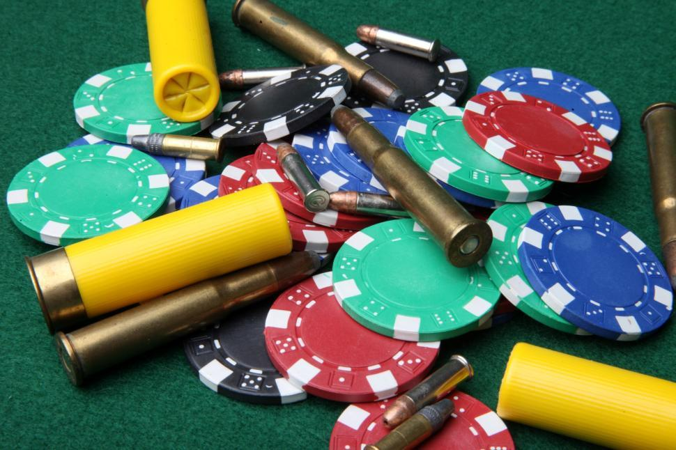 Download Free Stock Photo of Bullets and poker chips