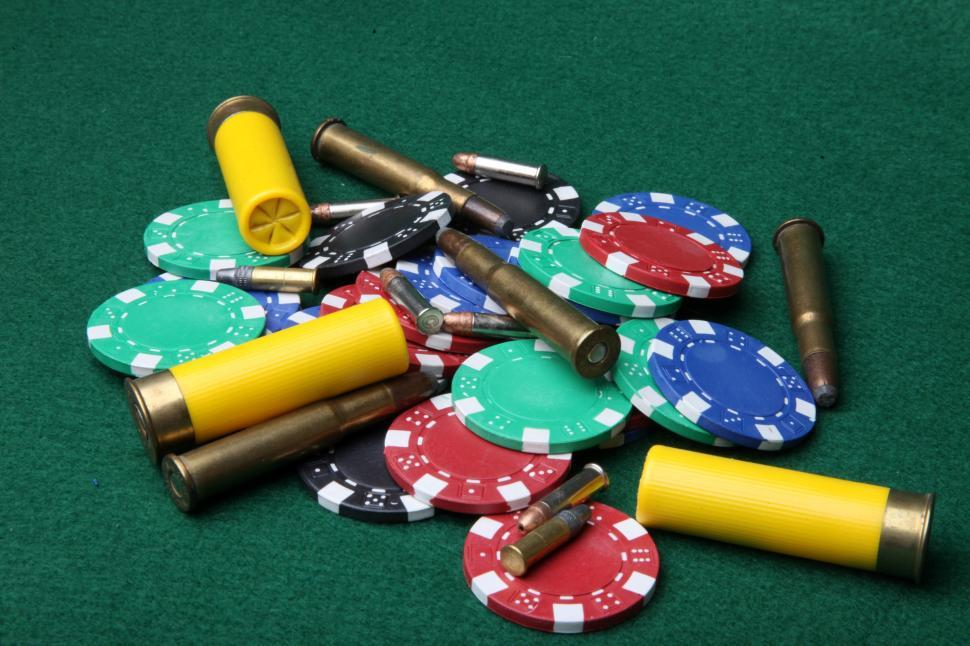 Download Free Stock HD Photo of Bullets and poker chips Online
