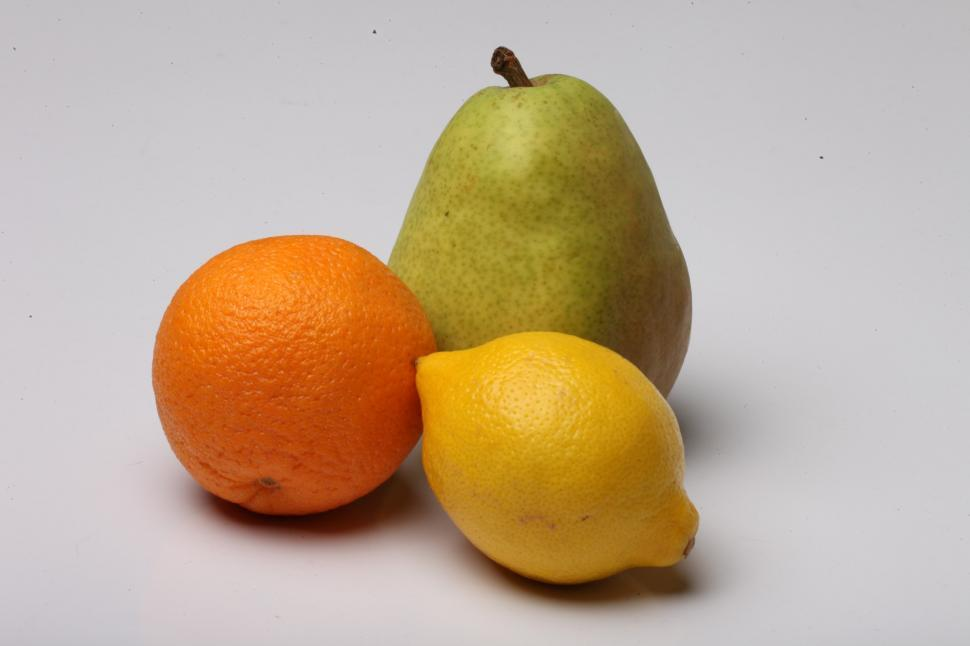 Download Free Stock HD Photo of Orange, Pear and Lemon isolated on white Online