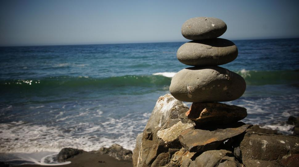 Download Free Stock Photo of Rock Stacking by the Ocean