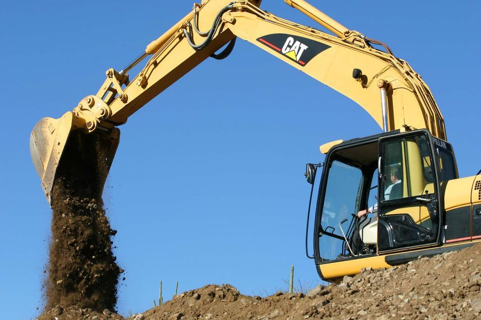 Download Free Stock Photo of Large digger moving dirt