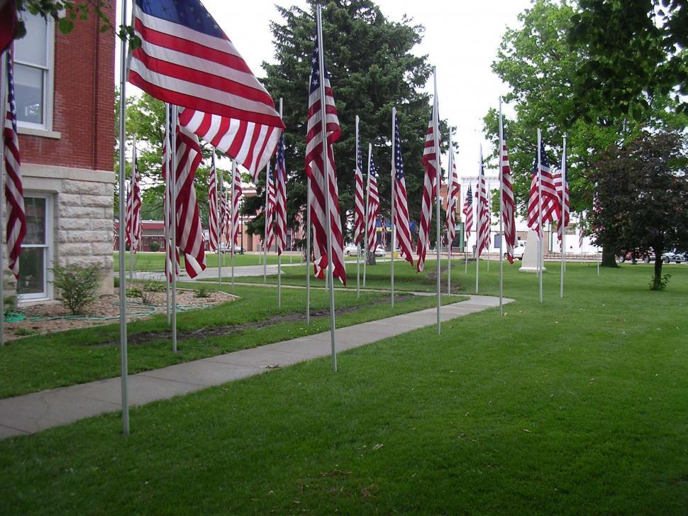 Download Free Stock Photo of Flags around small town courthouse on Memorial Day