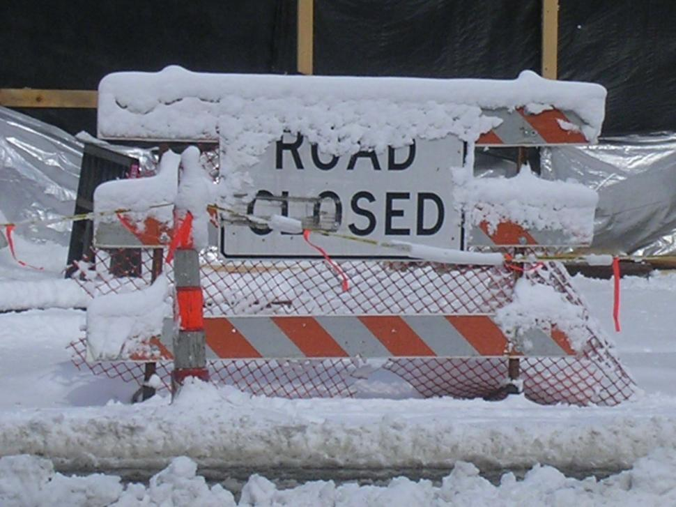 Download Free Stock Photo of Snow covered road closed sign