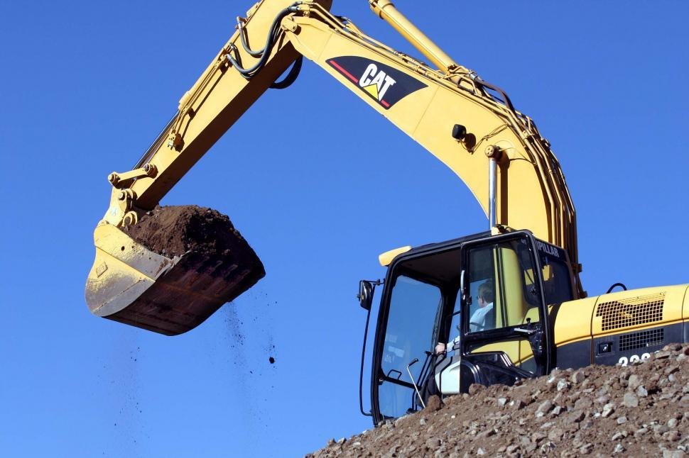 Download Free Stock Photo of Excavator with bucket of dirt