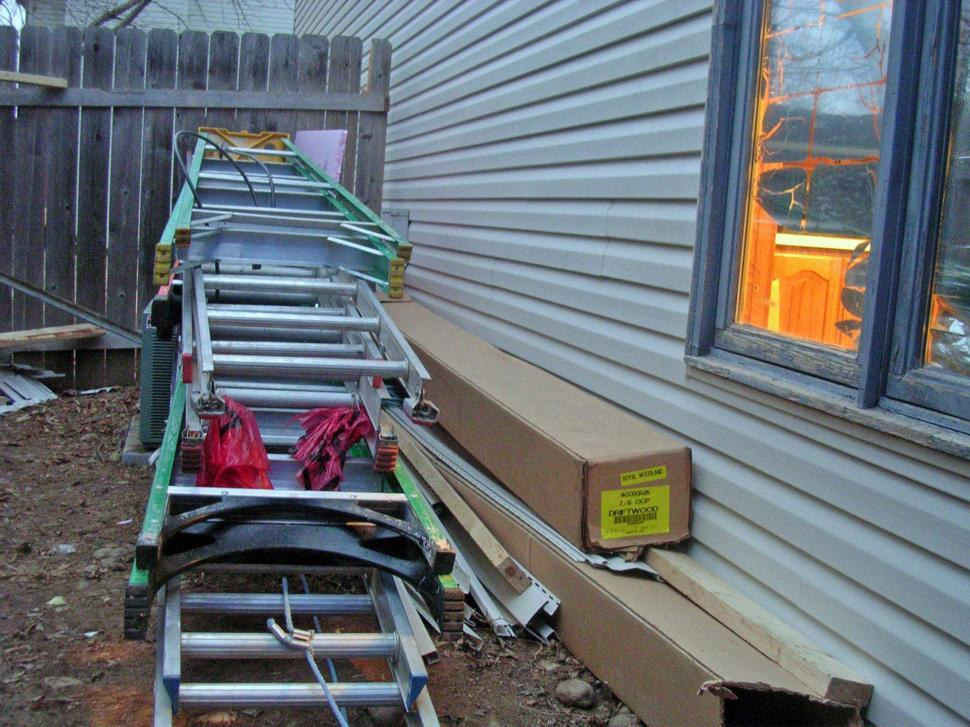 Download Free Stock Photo of Ladders for siding work