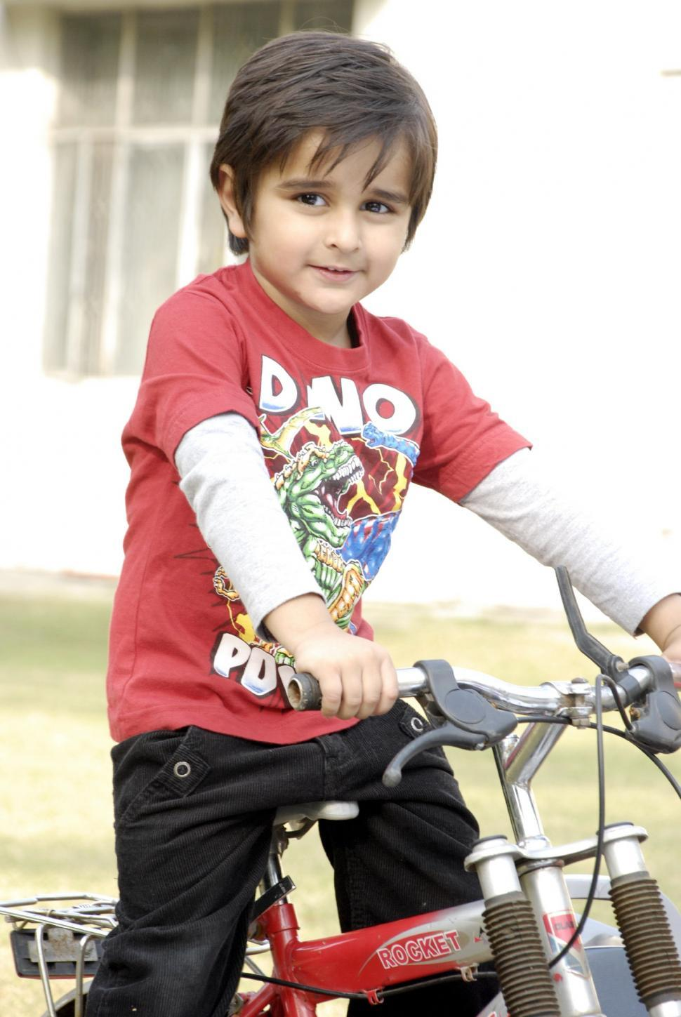 Download Free Stock HD Photo of Cute Kid with Bicycle Online