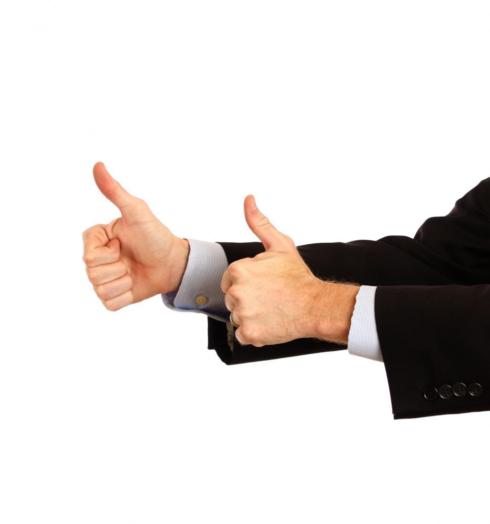 Download Free Stock HD Photo of A young businessman making a thumbs up gesture Online