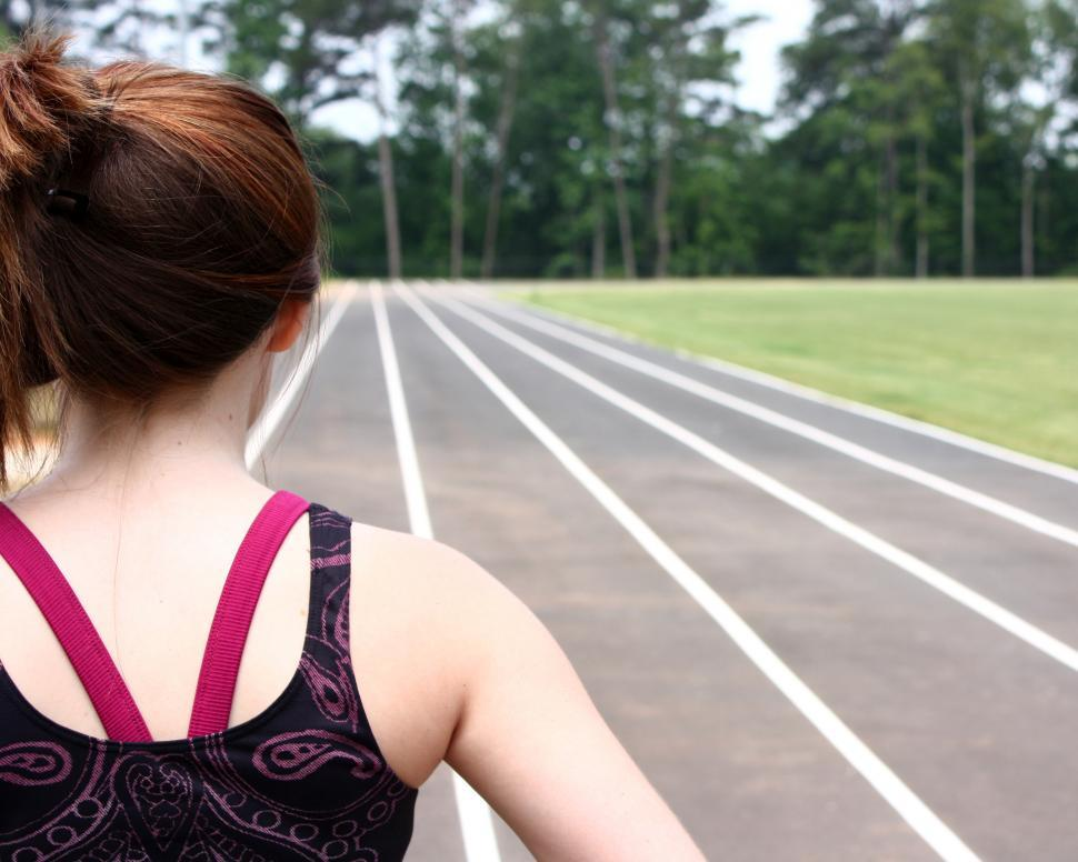 Download Free Stock HD Photo of A cute young girl on a track field Online