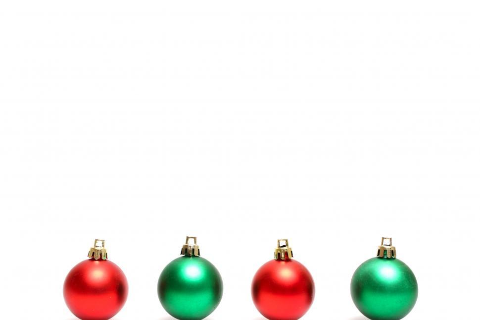 Download Free Stock HD Photo of Red and green Christmas ornaments isolated on a white background Online