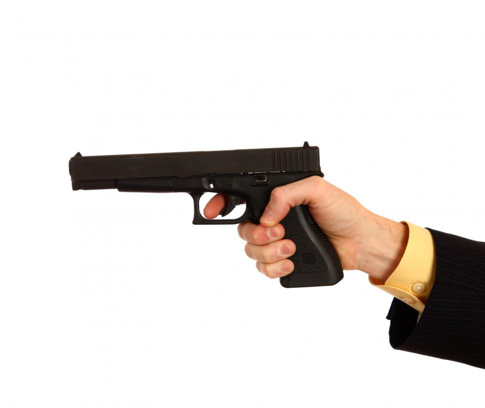 Download Free Stock Photo of A hand in a business suit holding a pistol