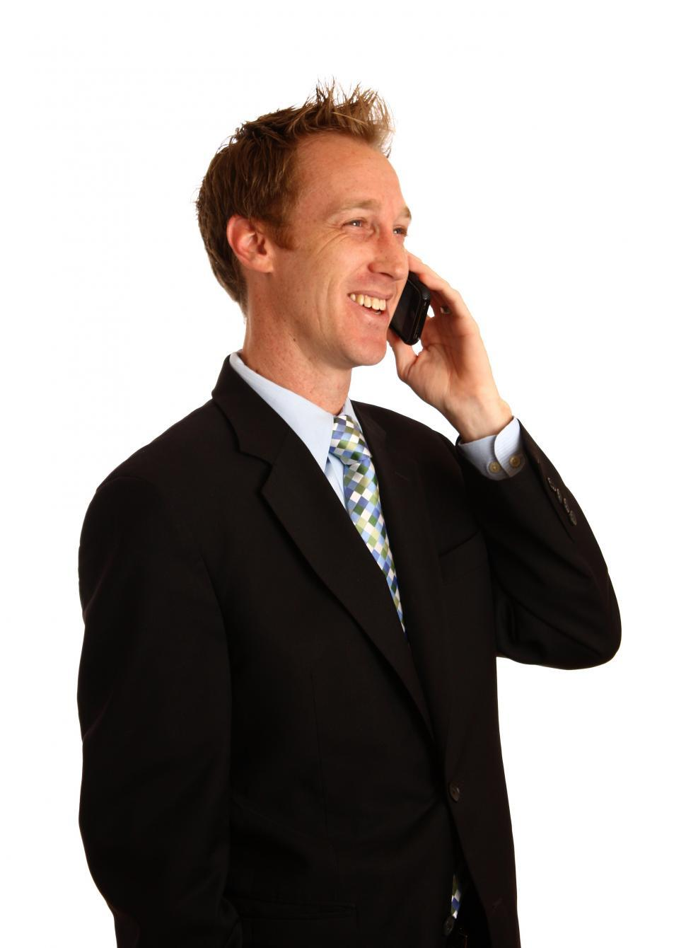 Download Free Stock HD Photo of A young businessman talking on a cell phone Online