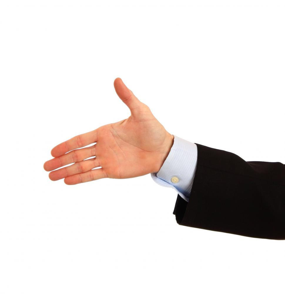Download Free Stock HD Photo of A hand being held out for a handshake Online