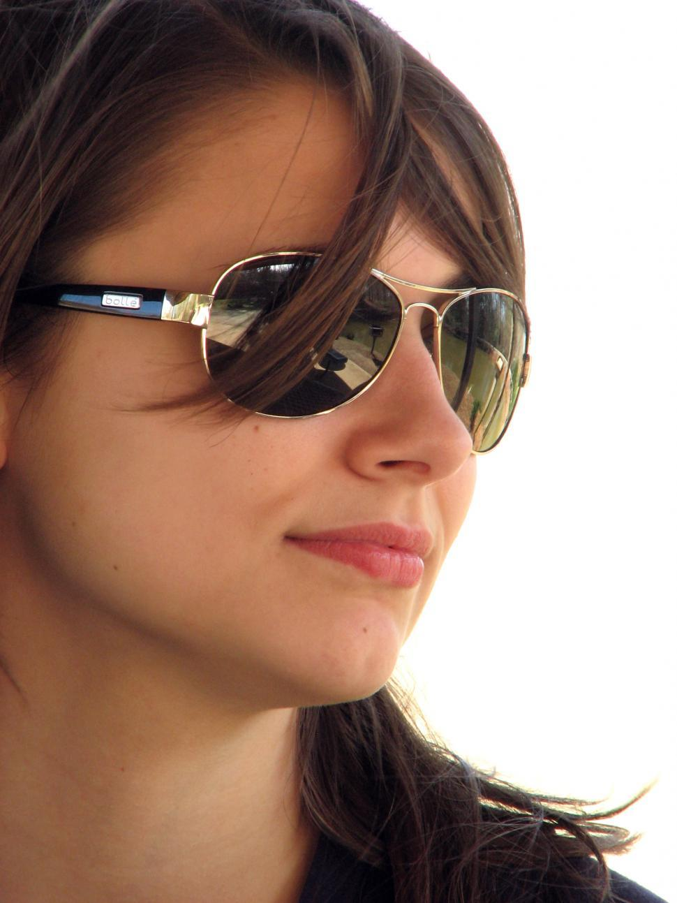 Download Free Stock Photo of Close-up portrait of a beautiful girl wearing sunglasses