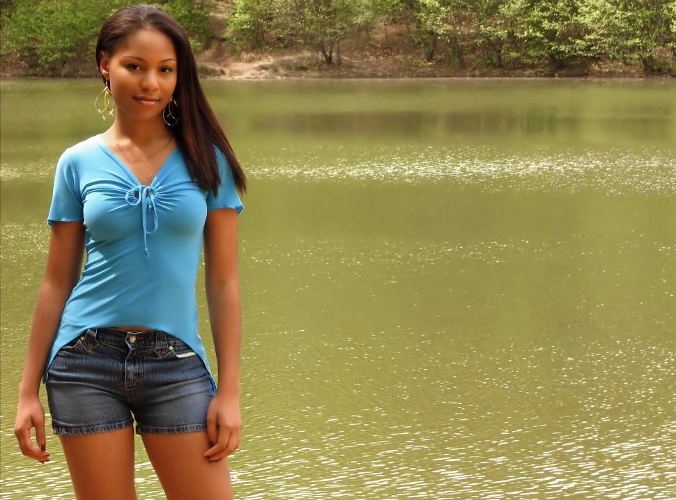 Download Free Stock Photo of Portrait of a beautiful African American teen girl posing by a lake