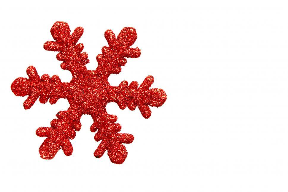 Download Free Stock HD Photo of A red snowflake shaped Christmas ornament isolated on a white background Online