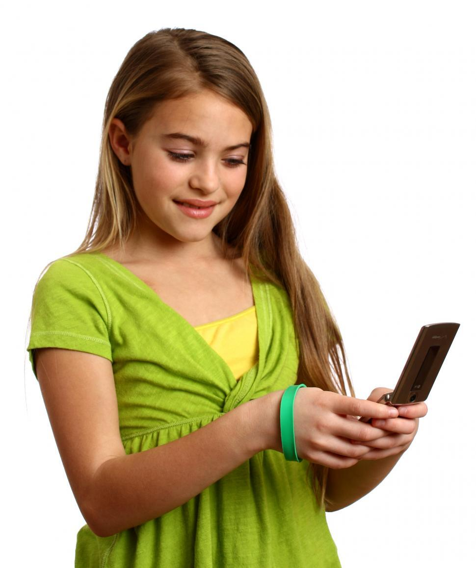 Download Free Stock Photo of A beautiful young girl texting on a cell phone