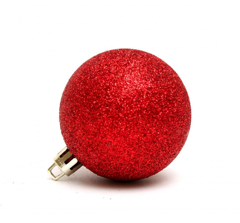 Download Free Stock Photo of A red Christmas ornament isolated on a white background