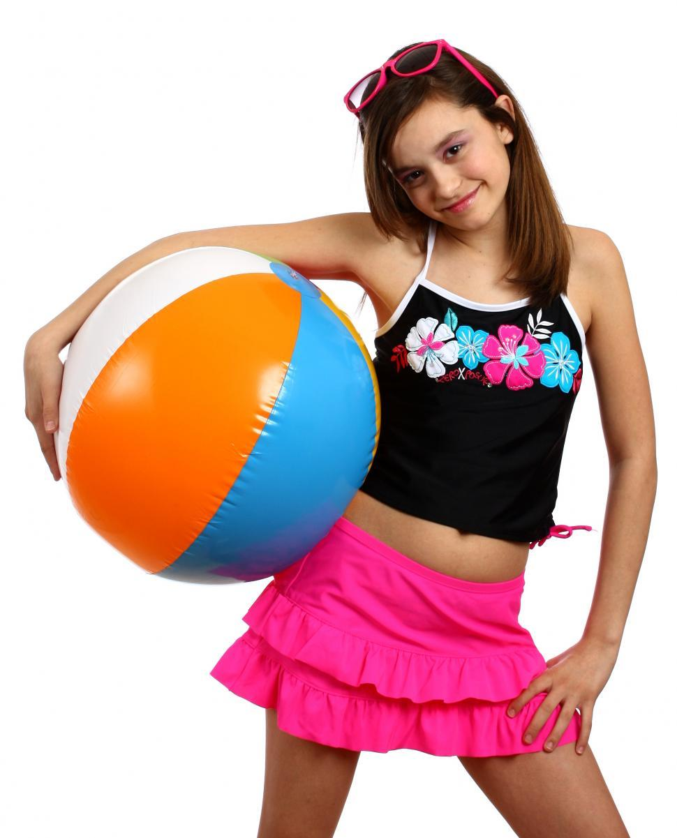 Download Free Stock Photo of A cute young girl posing with a beach ball