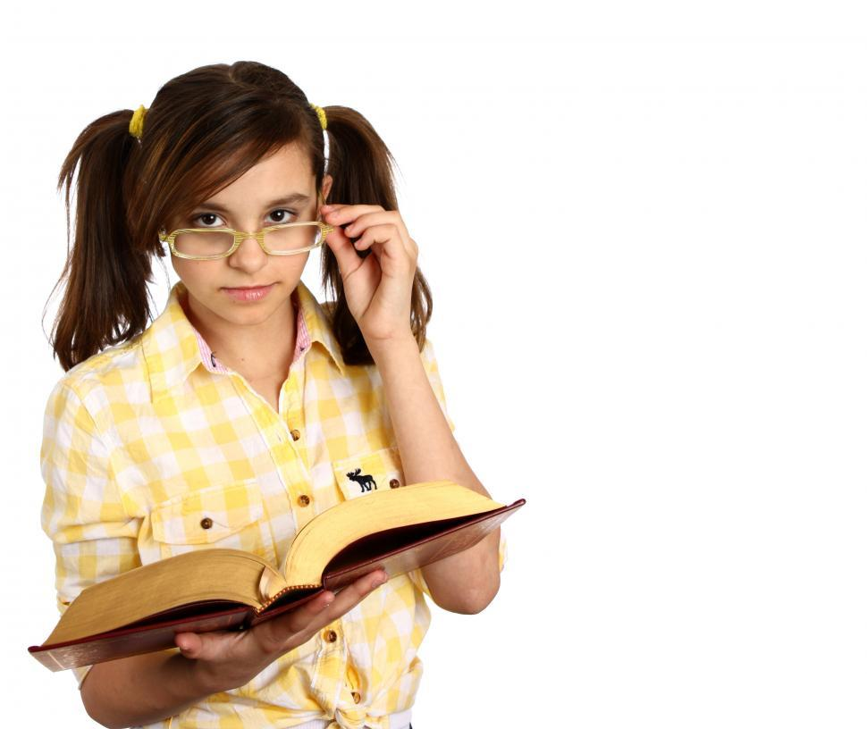 Download Free Stock Photo of A smart girl with glasses reading a book