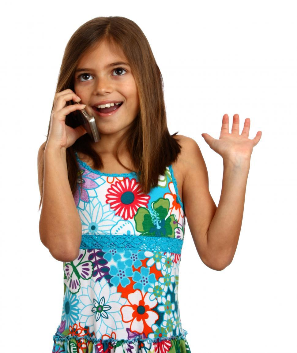 Download Free Stock HD Photo of A pretty young girl talking on a cell phone Online