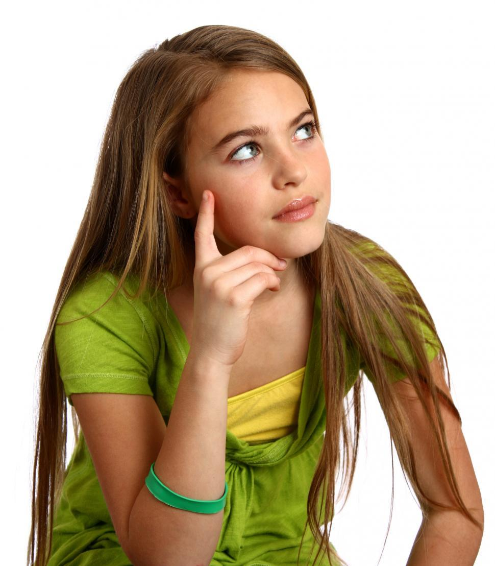 Download Free Stock Photo of A beautiful young girl with a thoughtful expression