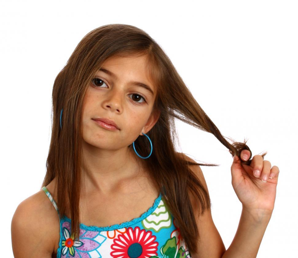 Download Free Stock Photo of A pretty young girl pulling on her hair