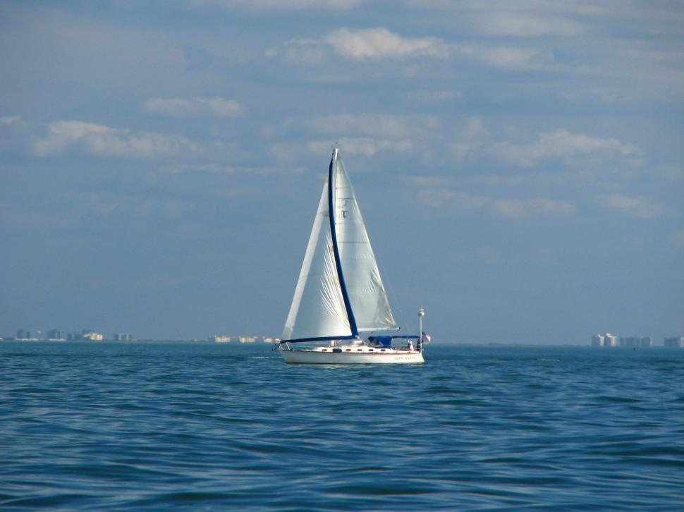 Download Free Stock Photo of A sailboat on the ocean