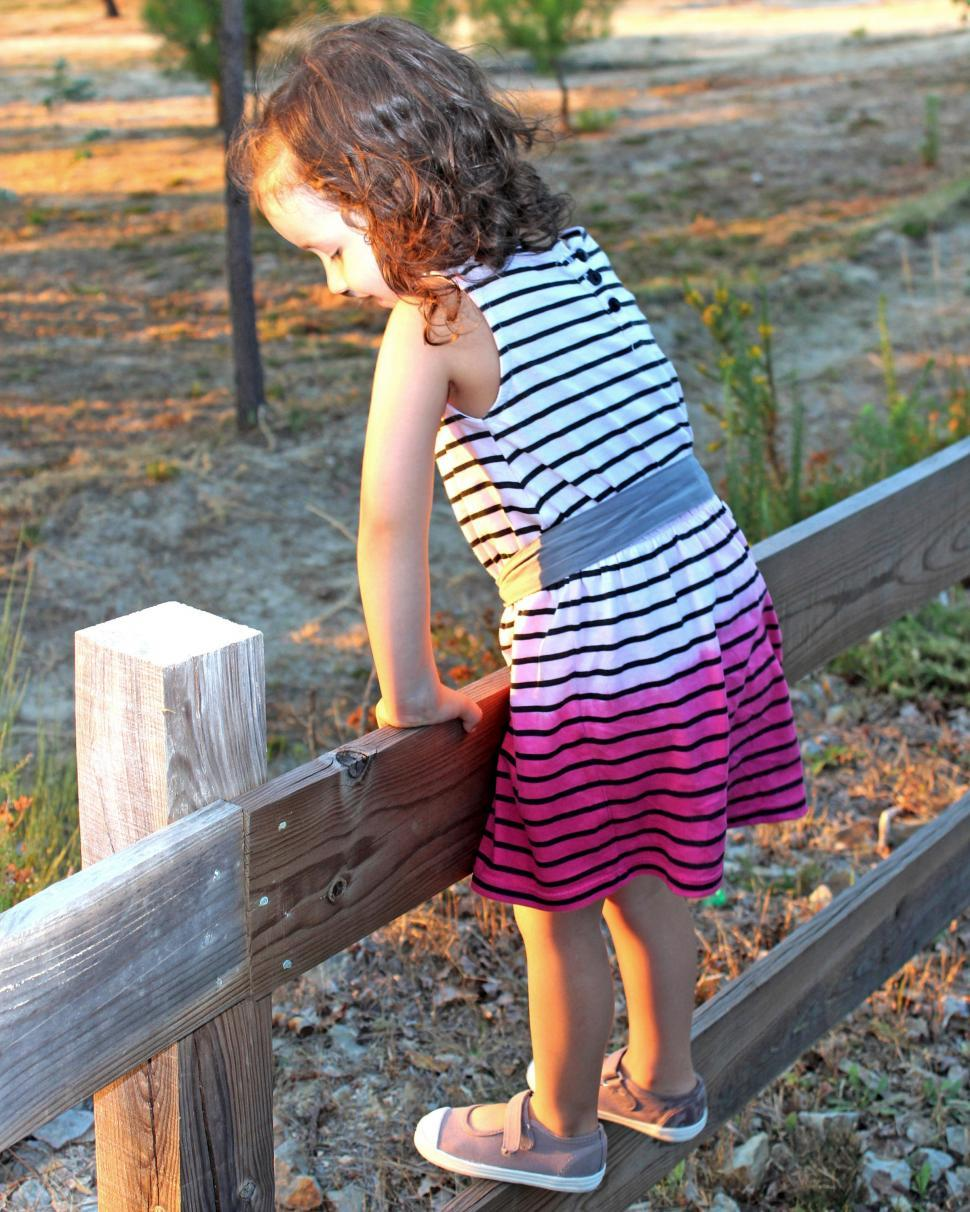 Download Free Stock HD Photo of Child on a wooden fence Online