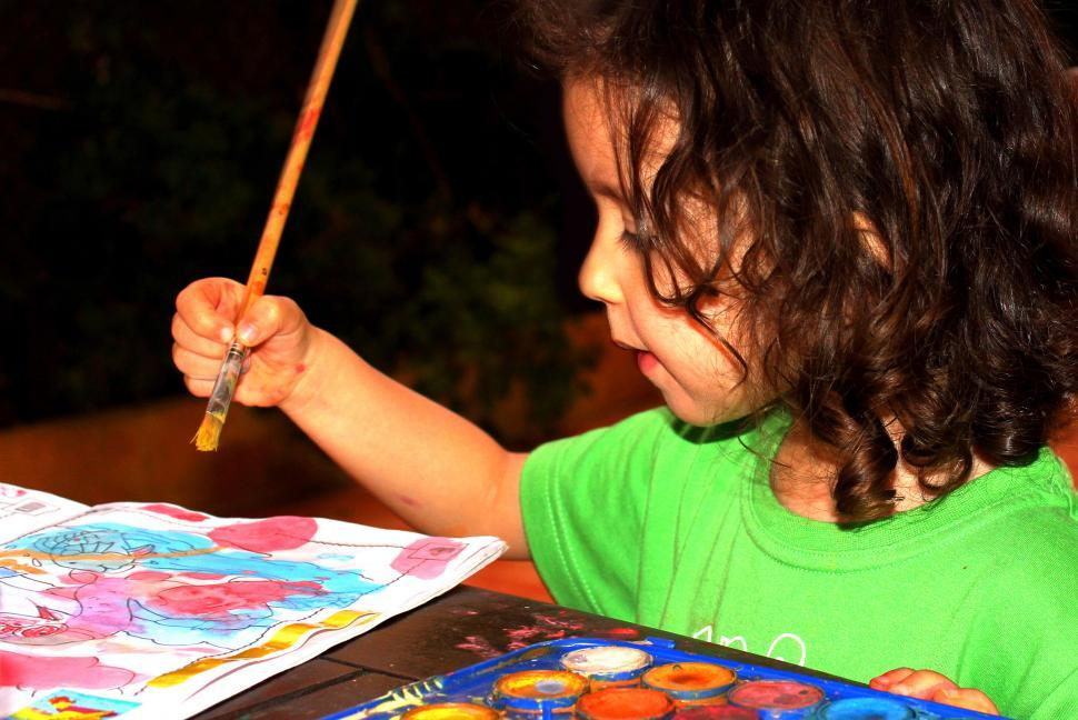 Download Free Stock HD Photo of Child painting a watercolor Online